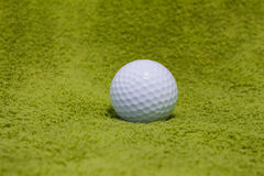 Golf ball on grass. Background Royalty Free Stock Photos