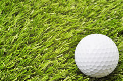 Golf Ball on Grass with Copy Space Stock Images