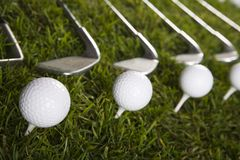 Golf ball on grass with driver Stock Image