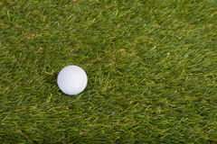 Golf ball on grass field Stock Images