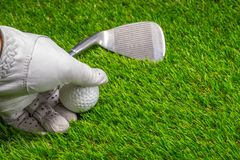 Pick up golf ball on grass royalty free stock photo
