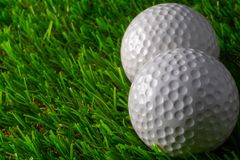 Two golf ball on grass. Activity background beautiful close club color competition copy course day detail equipment fairway field game golfball golfer golfing royalty free stock image
