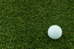 Golf ball. On the grass ground Stock Image