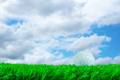 Golf ball on grass and quote. White golf ball on green artificial grass in beautiful off focus background and quote  practice is perfect Stock Photos