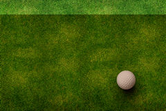 Golf ball on grass top view Royalty Free Stock Image