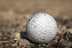 Golf ball on gravel Stock Image
