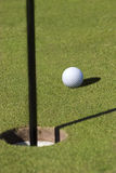 Golf ball on green. Stock Photos