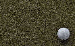 Golf ball on green with negative space royalty free stock photos