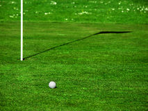 Golf Ball on Green. Golf ball on the green, near the hole royalty free stock photo