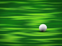 Golf ball on green Stock Images