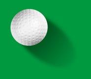 Golf ball on green. Background Stock Photos