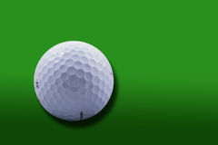 Golf Ball on green background. Golf Ball close-up over gradient green background Royalty Free Stock Image