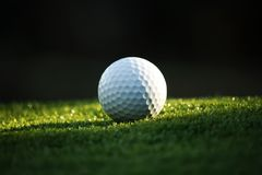 Golf ball on green in beautiful golf course at bokeh background. Golf equipment on green in golf course. Golf ball on green in beautiful golf course at bokeh royalty free stock photography