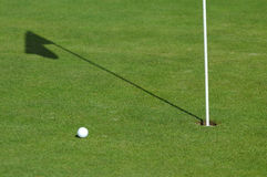 Golf ball on green course Stock Photography
