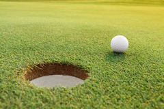Golf ball on the green course. Golf ball on the pure green course royalty free stock photography
