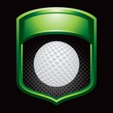 Golf ball on green display Royalty Free Stock Images