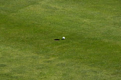 Golf ball on green field Stock Photo