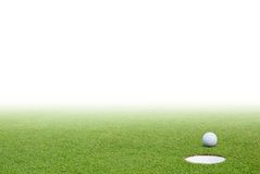Golf ball and green grass Royalty Free Stock Image