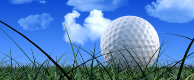 Golf Ball On Green Grass. A single, ground view, close up of a golf ball sitting grass with a blue cloudy sky in the background Royalty Free Stock Images