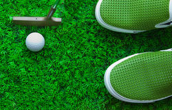 Golf ball on green grass. File of putter and Golf ball on green grass Stock Photos