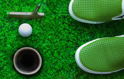 Golf ball on green grass. File of putter and Golf ball on green grass ready for putting Stock Photos