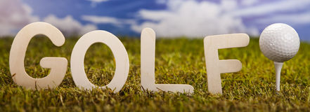 Golf ball on green grass Stock Images