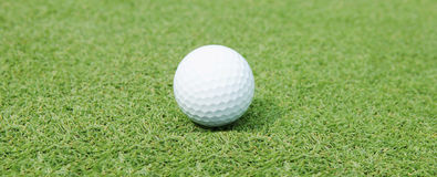 Golf Ball. On the Green Grass Royalty Free Stock Images