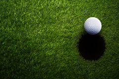 Golf ball on green grass from above Stock Image