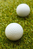 Golf ball. Golf ball on green grass background Royalty Free Stock Photography