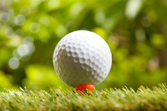 Golf ball. Golf ball on green grass background Royalty Free Stock Image