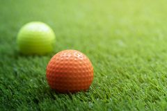 Golf ball on green grass. With copy space stock photo