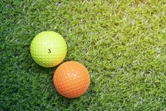 Golf ball on green grass with copy space. Top view royalty free stock images