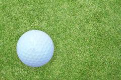 Golf ball on the green grass Royalty Free Stock Image