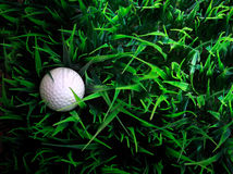 Golf ball on green grass field Royalty Free Stock Photography