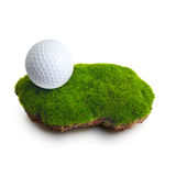 Golf ball on green grass royalty free stock image