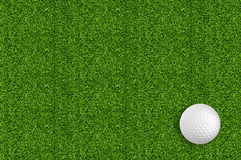 Golf ball on the green grass of the golf Stock Images