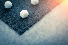 Golf ball on green grass Stock Photography