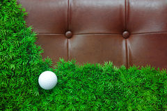 Golf ball on green grass and luxury leather. Background Royalty Free Stock Photography