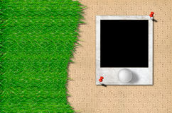 Golf ball and green grass with photo frame. Golf ball and green grass with old photo frame Royalty Free Stock Photos