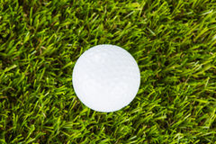 Golf ball on green grass placed Royalty Free Stock Photography