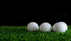 Golf ball on green grass. Row of golf ball on green grass  golf course Stock Photography
