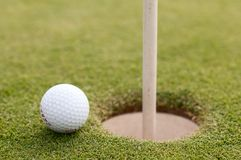 Golf ball on green grass, selective focus Stock Photo