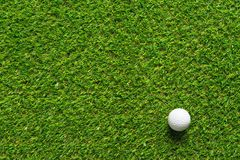 Golf ball on green grass texture of golf course for background. stock photo