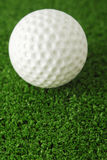 Golf ball on the green grass turf Royalty Free Stock Photography
