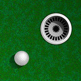 Golf ball on green. Golf Hole with Ball Top View Royalty Free Stock Image