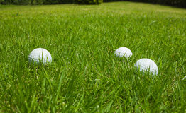 Golf ball on a green lawn. Golf ball on a green lawn Background Royalty Free Stock Photography