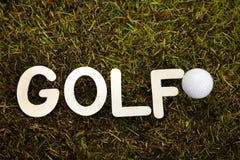 Golf ball on green meadow Stock Photos