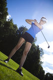 Golf ball on green meadow, driver Stock Photo