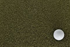 Golf ball on green with negative space royalty free stock photo