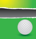 Golf ball on green ripped advertisement Stock Photo